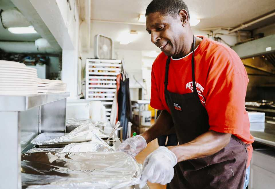 <strong>Herman Atkins, a volunteer at Memphis Union Mission, prepares lunch in the kitchen. Memphis Union Mission is about to start a $34 million expansion that will provide for a new kitchen and expanded space to serve the homeless.</strong> (Houston Cofield/Daily Memphian)
