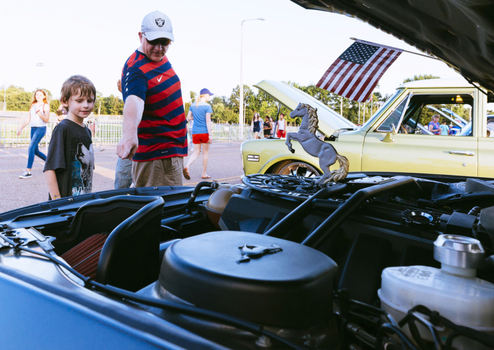 <strong>Terry Fletcher looks at classic cars with son Miles Fletcher at Bartlett&rsquo;s annual Star Spangled Fireworks Extravaganza on July 3, 2019. This is the 21st year Bartlett has held the event at the Bobby K. Flaherty Municipal Center on Appling.&nbsp;</strong>(Ziggy Mack/Special to The Daily Memphian)