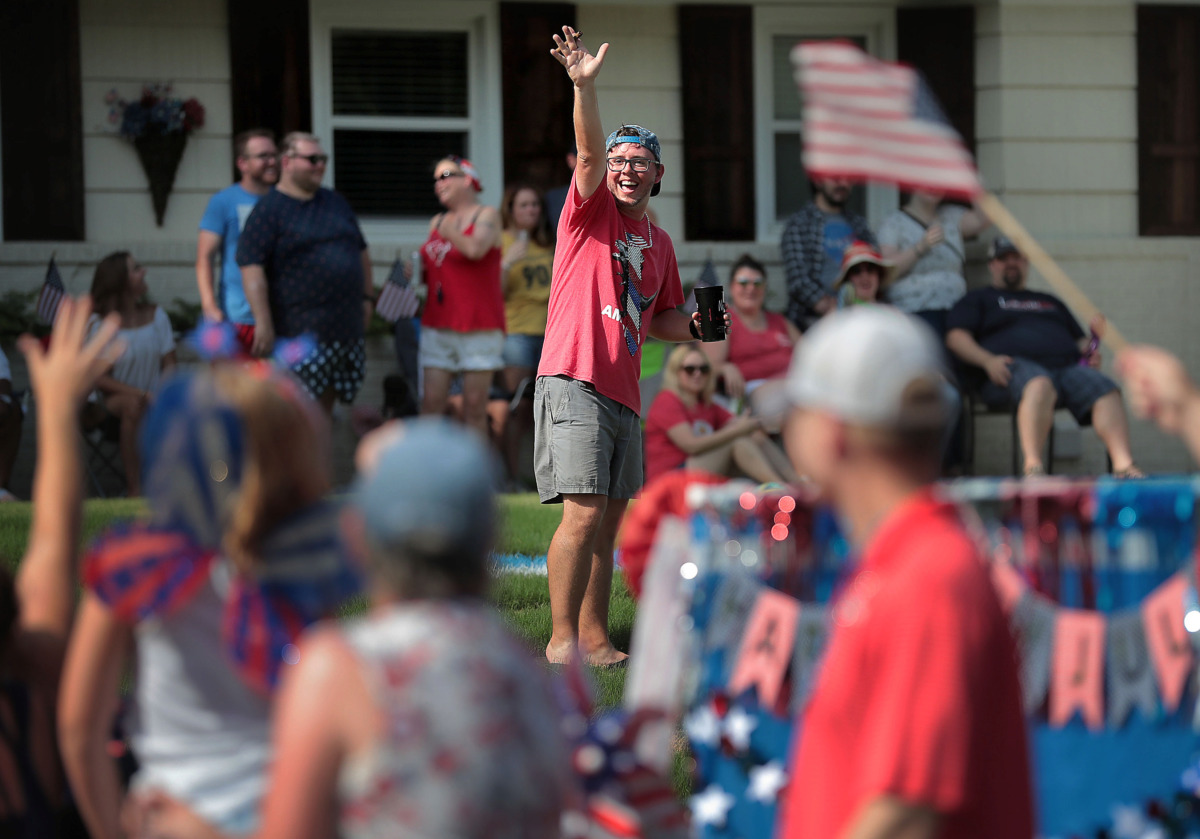 <strong>Neighbors gather to watch the parade as it passes on Mimosa Avenue during the 70th annual Independence Day Parade in the High Point Terrace neighborhood on July 4, 2019. Once again East Memphis residents gathered for a patriotic morning of star-spangled bikes, waving neighbors and a dousing by the Memphis Fire Department.</strong> (Jim Weber/Daily Memphian)