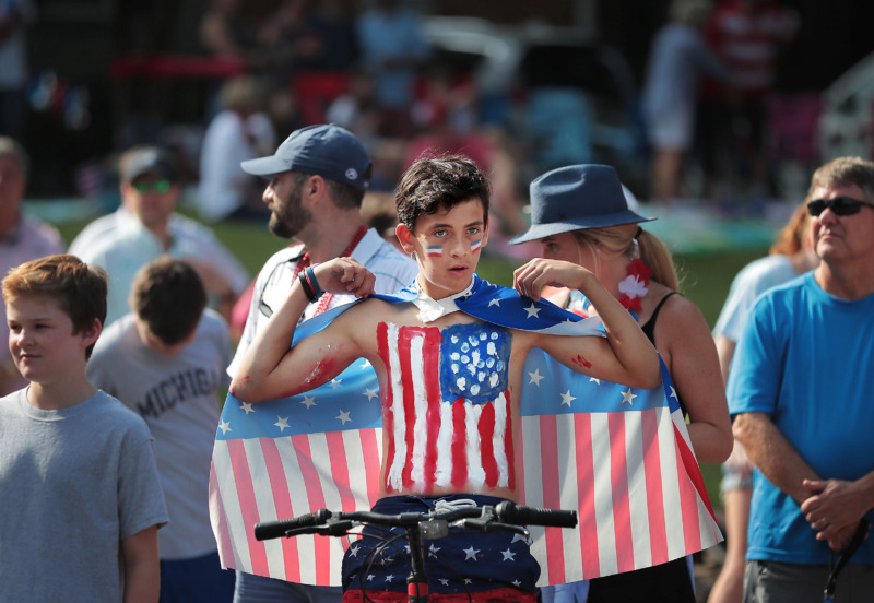 <strong>C.J. Weaver adjusts his cape as folks line up for the 70th annual Independence Day Parade in the High Point Terrace neighborhood on July 4, 2019. East Memphis residents gathered for a patriotic morning of star-spangled bikes, waving neighbors and a dousing by the Memphis Fire Department.</strong> (Jim Weber/Daily Memphian)