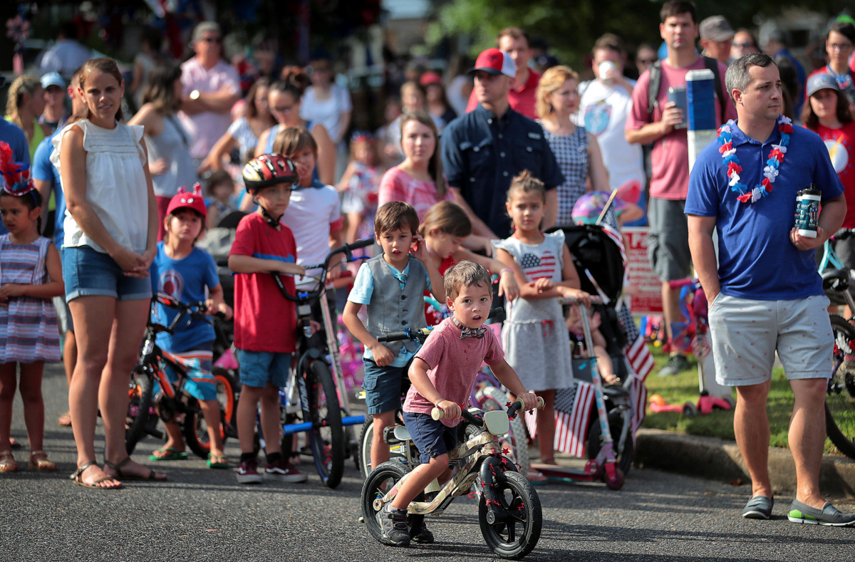 <strong>Parade-goers line up during the 70th annual Independence Day Parade in the High Point Terrace neighborhood on July 4, 2019. Once again East Memphis residents gathered for a patriotic morning of star spangled bikes, waving neighbors and a dousing by the Memphis Fire Department.</strong> (Jim Weber/Daily Memphian)