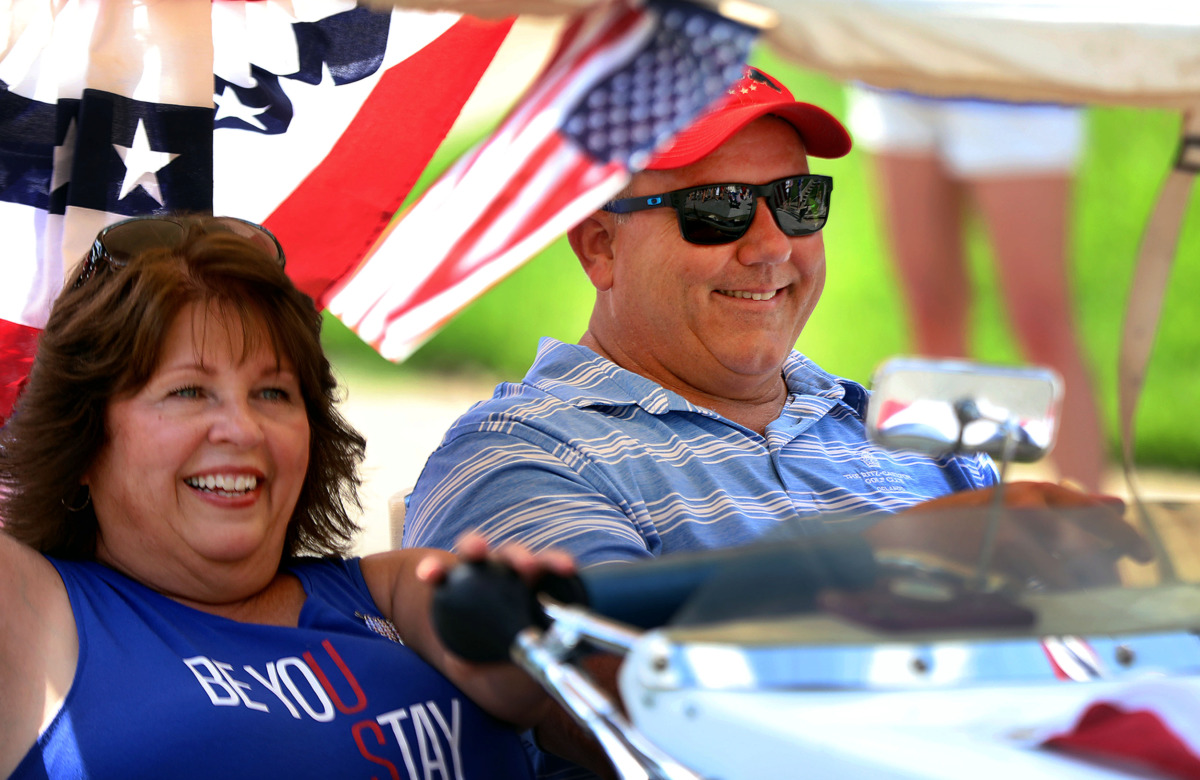 <strong>Joni and John Chalmers peddle their PPV (person powered vehicle) down Carr Avenue during the Central Gardens Fourth of July parade</strong>. (Patrick Lantrip/Daily Memphian)