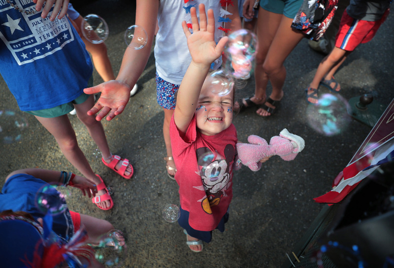 <strong>Scarlet Pentecost, 3, pops clouds of bubbles from one of the floats at the 70th annual Independence Day Parade in the High Point Terrace neighborhood on July 4, 2019. Once again East Memphis residents gathered for a patriotic morning of star-spangled bikes, waving neighbors and a dousing by the Memphis Fire Department.</strong> (Jim Weber/Daily Memphian)