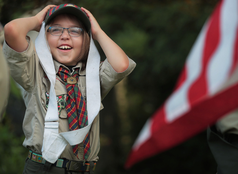 <strong>Cooper Bruce struggles a little with his flag-carrying harness before the start of the 70th annual Independence Day Parade in the High Point Terrace neighborhood on July 4, 2019. Once again East Memphis residents gathered for a patriotic morning of star-spangled bikes, waving neighbors and a dousing by the Memphis Fire Department.</strong> (Jim Weber/Daily Memphian)