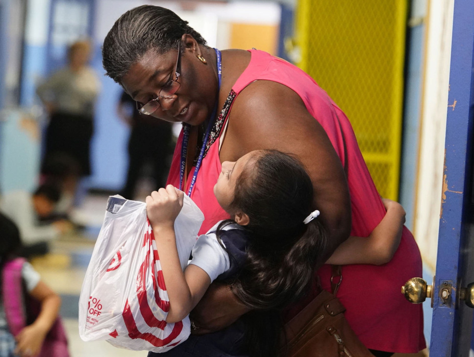 <strong>A teacher at Our Lady of Sorrows in Frayser says goodbye to one of her students on the last day of school this year. The Jubilee Schools in Memphis closed at the end of May, with many of the schools reopening as charter schools.</strong> (Karen Pulfer Focht/Special to The Daily Memphian)