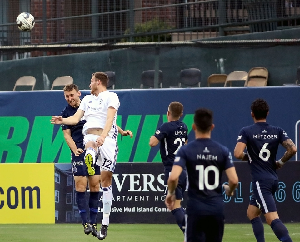 <strong>Memphis 901 FC defender Todd Pratzner (20) goes up for a header during the&nbsp; Saturday match against Hartford.</strong> (Patrick Lantrip/Daily Memphian)