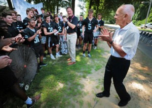<strong>Major benefactor Mike Bruns (right) talks to the football team before a ceremony on July 10, 2019, at Houston High School to mark the start of construction on a new field house to be located adjacent to the football field. </strong>&nbsp;(Jim Weber/Daily Memphian)