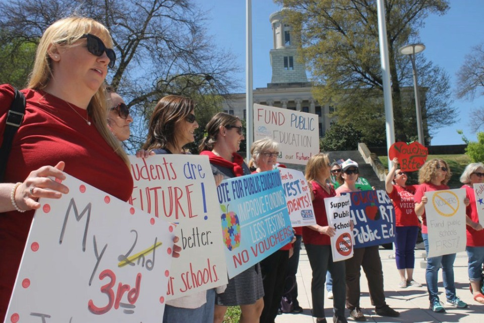 "<div id=""attachment_208668"" class=""article-img alignleft""> <div class=""wp-caption-text""><strong><strong>Teachers and parents rally against voucher legislation this past spring outside of Tennessee&rsquo;s State Capitol in Nashville. </strong></strong>(Marta W. Aldrich/Chalkbeat)</div> </div>"