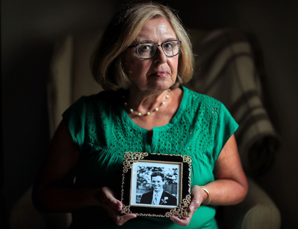 <strong>Laurie Higginbotham, shown here at her East Memphis home on July 11, 2019, has been pushing for tougher truck safety laws and regulations since her son Michael died in 2014 in a crash with a big rig that was making a U-turn on Walnut Grove at Interstate 240.</strong> (Jim Weber/Daily Memphian)