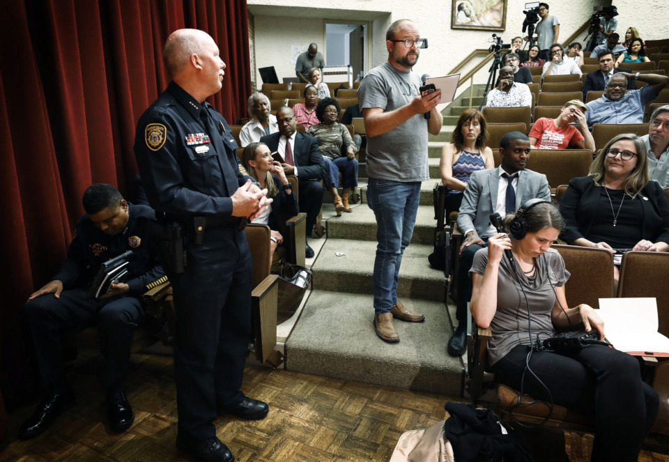 <strong>At the request of the crowd, activist Hunter Demster (right) reads the notes of Memphis Police Deputy Chief Don Crowe (left), who also attended a public forum Thursday, July 11, at Mississippi Boulevard Christian Church to discuss MPD&rsquo;s surveillance conduct. Attendees offered questions to a monitoring team about a court-ordered plan to bring reform to the MPD after officers were found conducting illegal surveillance of protesters, violating a 40-year-old consent decree barring such surveillance.</strong> (Mark Weber/Daily Memphian)