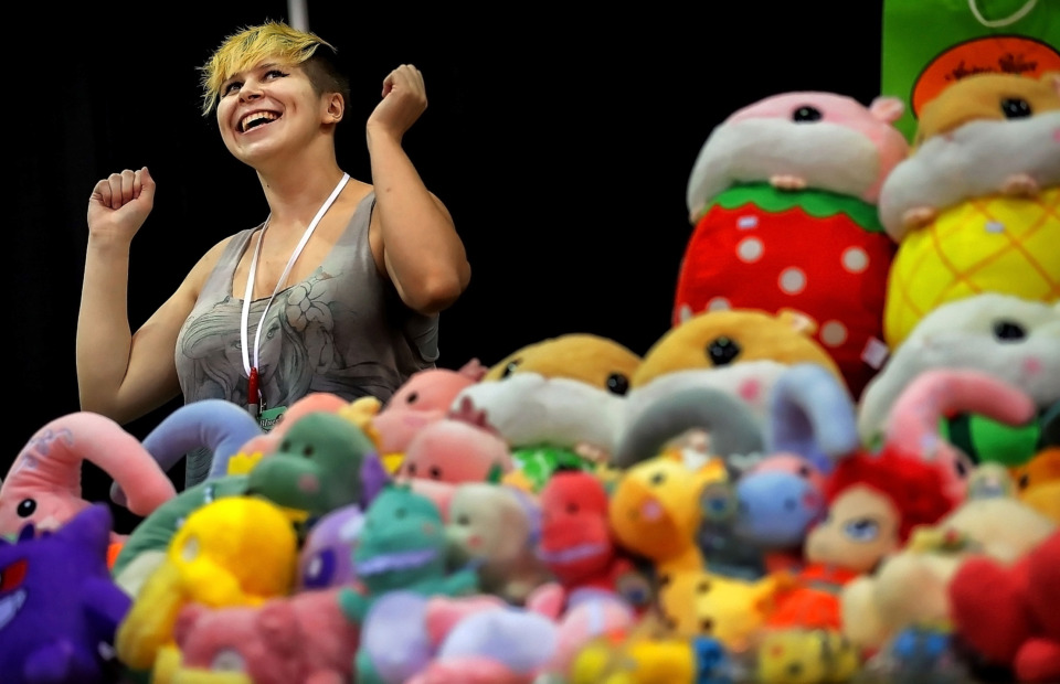 <strong>Vendor Eli Childress of Denver, Colorado, jokes with customers while selling stuffed versions of their favorite anime characters at Anime Blues Con 9 at the Memphis Convention Center on Friday, July 12. Organizers expect some 4,000 fans at the event, which includes cosplay competitions, memorabilia vendors, video games and celebrity speakers. </strong>(Jim Weber/Daily Memphian)