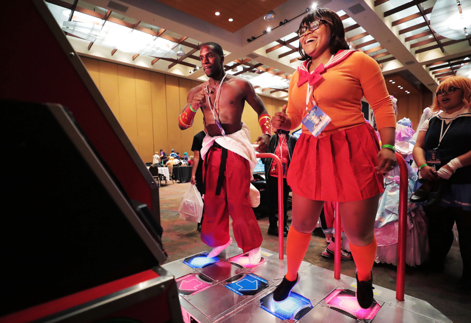 <strong>Derek Alexander and Amanda Gray take a turn at Dance Dance Revolution at Anime Blues Con 9 at the Memphis Convention Center on Friday, July 12.</strong> (Jim Weber/Daily Memphian)