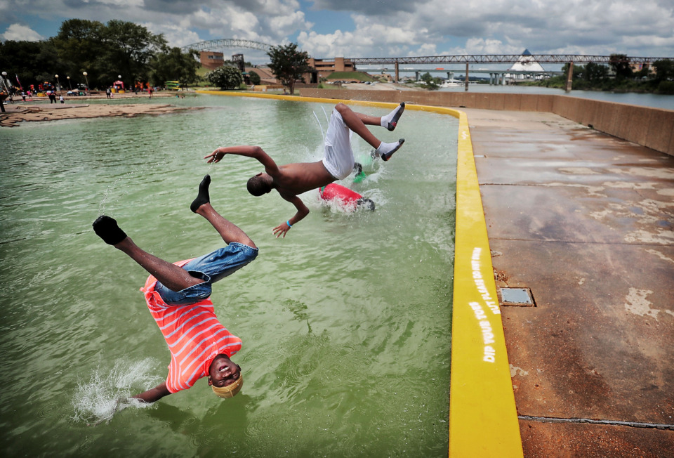 <strong>Unable to resist the cool water on a hot day, Terrance Gaither (left) and Tysean Gaither take a plunge in Mud Island's Gulf of Mexico during dueling events on July 13, 2019 at Mud Island River Park. </strong>&nbsp;(Jim Weber/Daily Memphian)