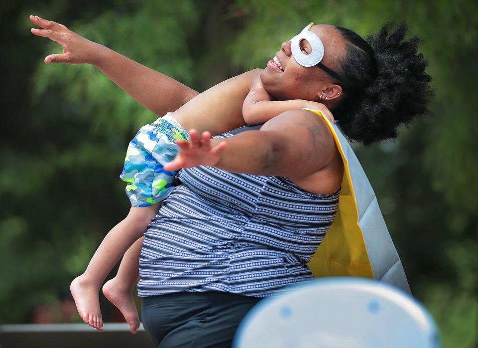 <strong>Kamila McDaniel channels her superhero mom persona, taking son Josiah McDaniel for a flight during&nbsp;<span>Neighborhood Heroes: Superhero Training Day</span> on July 13, 2019, at Mud Island River Park. </strong>(Jim Weber/Daily Memphian)