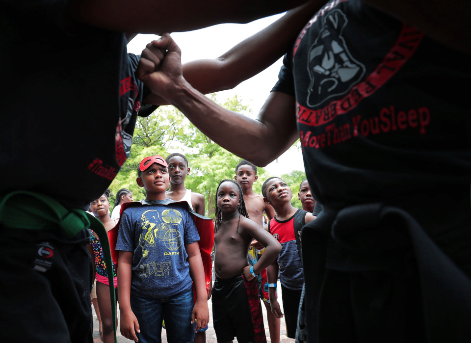 <strong>Mustafha Muhammad (left) and Michael Muhammad (right) offer a few self-defense pointers during&nbsp;<span>Neighborhood Heroes: Superhero Training Day</span> on July 13, 2019 at Mud Island River Park.</strong> (Jim Weber/Daily Memphian)