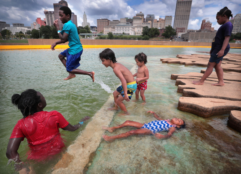 <strong>Kids beat the heat in Mud Island's Gulf of Mexico during dueling events on July 13, 2019, at Mud Island River Park. Families turned out for the Big Birthday Bash to celebrate summer birthdays and for the&nbsp;<span>Neighborhood Heroes: Superhero Training Day,</span>&nbsp;during which kids learned about superheroes as a way of becoming more responsible citizens.</strong> (Jim Weber/Daily Memphian)