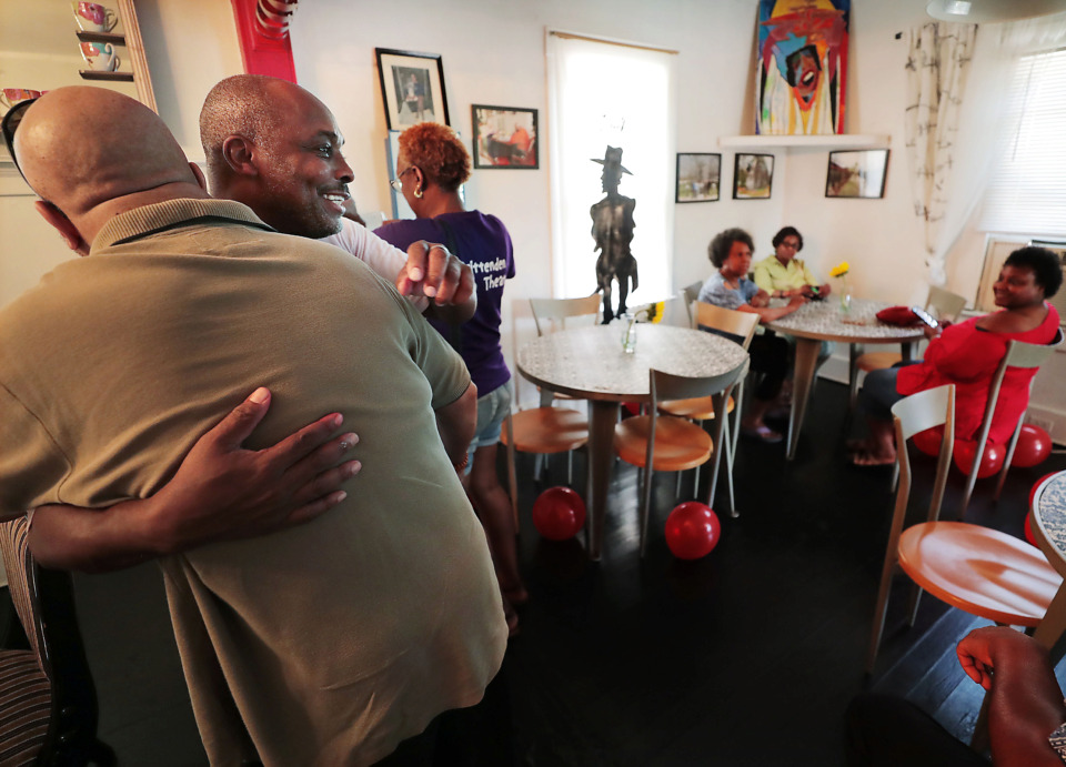 <strong>On July 13, 2019, Talbert Fleming (second from left) warmly greets guests to Jim and Samella's, the little soul food restaurant he and his brother Sheldon opened six years ago and named after their grandparents in South Memphis. The restaurant reopened Saturday after renovations.</strong> (Jim Weber/Daily Memphian)