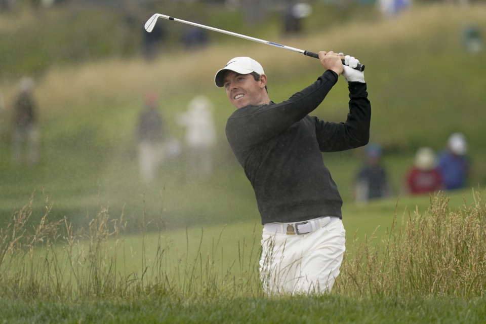 """<p class=""""regdt""""><strong>Rory McIlroy, of Northern Ireland, hits out of the bunker on the 10th hole during a practice round for the U.S. Open Championship Wednesday, June 12, 2019, in Pebble Beach, California.&nbsp;McIlroy has commited to play in next week's WGC-FedEx St. Jude Invitational</strong>. (AP Photo/David J. Phillip)"""