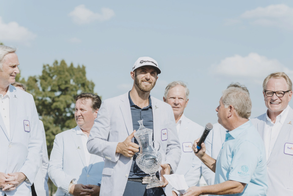 <strong>Dustin Johnson, winner of the 2018 FedEx St. Jude Classic, accepts the tournament trophy on the 18th green at TPC Southwind on June 10, 2018. Johnson, who is No. 2 in the World Golf Rankings, is among the favorites to win the inaugural World Golf Championships-FedEx St. Jude Invitational next week.&nbsp;</strong>(Houston Cofield/Daily Memphian file)