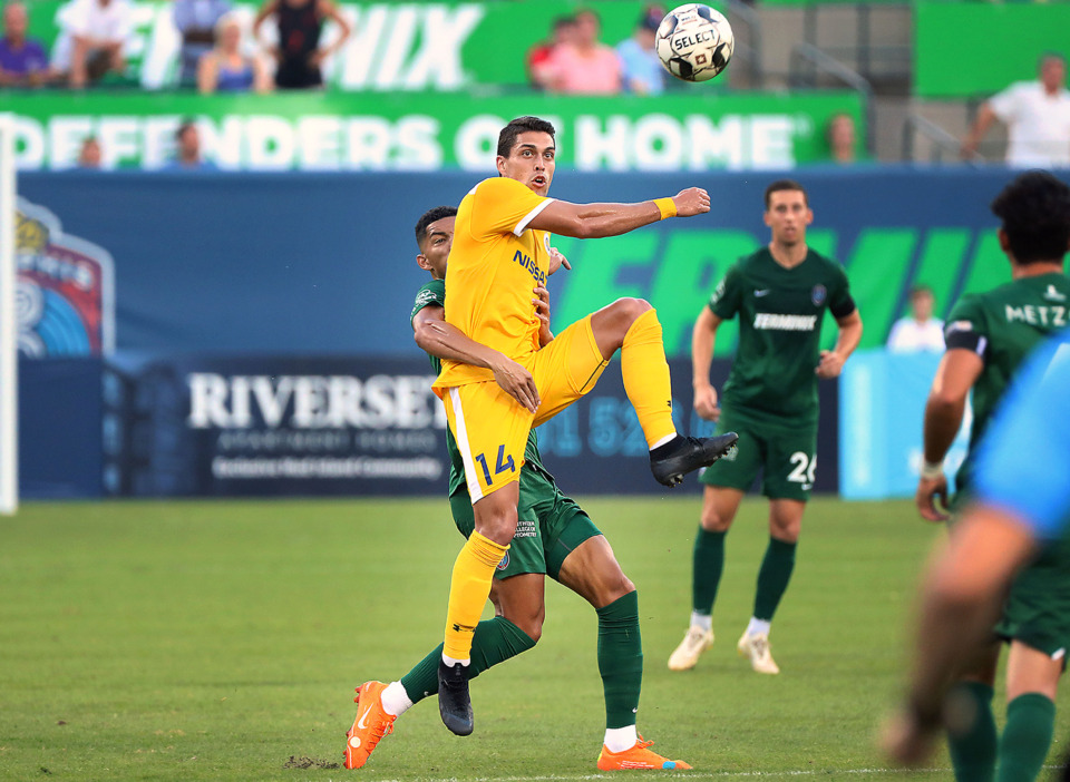 <strong>Memphis defender Jacob Hauser-Ramsey (15) tries to prevent Nashville SC forward Daniel R&iacute;os from reaching a high ball during a match Wednesday, July 17, 2019. Memphis fell 2-0.</strong> (Patrick Lantrip/Daily Memphian)
