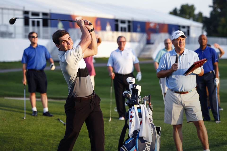 <strong>Former St. Jude Research Hospital patient Bradley Hamilton takes a charity fairway shot during a World Golf Championships-FedEx St. Jude Invitational preview event Thursday, July 18, 2019, at TPC Southwind.</strong> (Mark Weber/Daily Memphian).