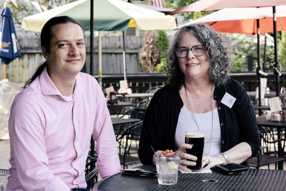 <strong>Christopher Darling, general manager of Celtic Crossing, sits with Helen Fernety, CEO and founder of Menus4ALL, on the patio of Celtic Crossing. The restaurant is one of the venues in Memphis that has adopted a menu that helps visually impaired individuals navigate food and drink items.</strong>&nbsp;(Houston Cofield/Special to the Daily Memphian)