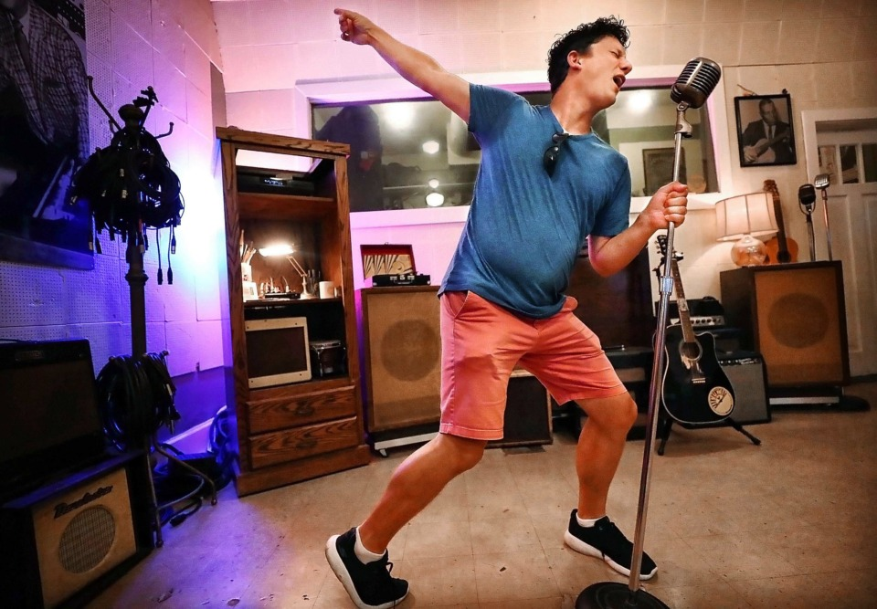 <strong>Derek Parten of Augusta, Ga., does his best Elvis impersonation during a tour of the Sun Records studio on July 9. Memphis Tourism has turned to data mining to aid its tourism marketing efforts using data and analytics to expand the Memphis brand to new markets.</strong> (Jim Weber/Daily Memphian)