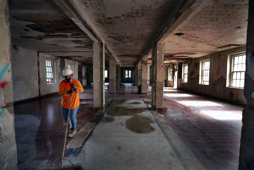 <strong>Construction crews are starting the yearlong, $18.5 million construction project by refurbishing concrete floors in the old hospital.</strong> (Patrick Lantrip/Daily Memphian)