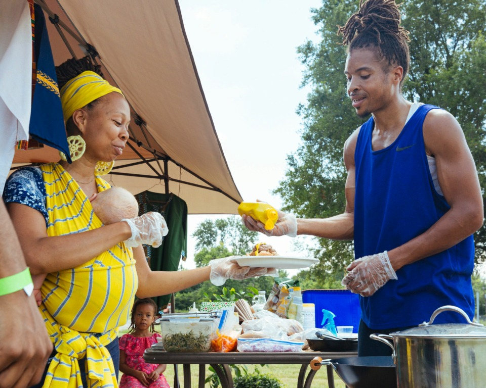 <strong>Mary and Victor Cooper prepare meatless hotdogs at Balewa's Vegan stand at the Vegan Festival in Frayser.</strong> (Ziggy Mack/Special to Daily Memphian)