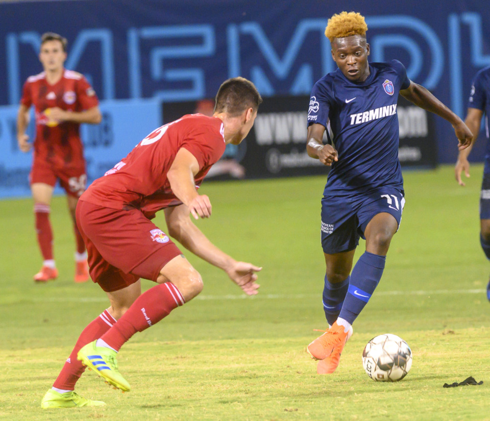 <strong>Memphis 901 FC forward Lagos Kunga goes up against NY Redbulls defender Sean Nealis during Saturday night's match, which ended in a 2-2-tie</strong>. (Greg Campbell/Special to Daily Memphian)