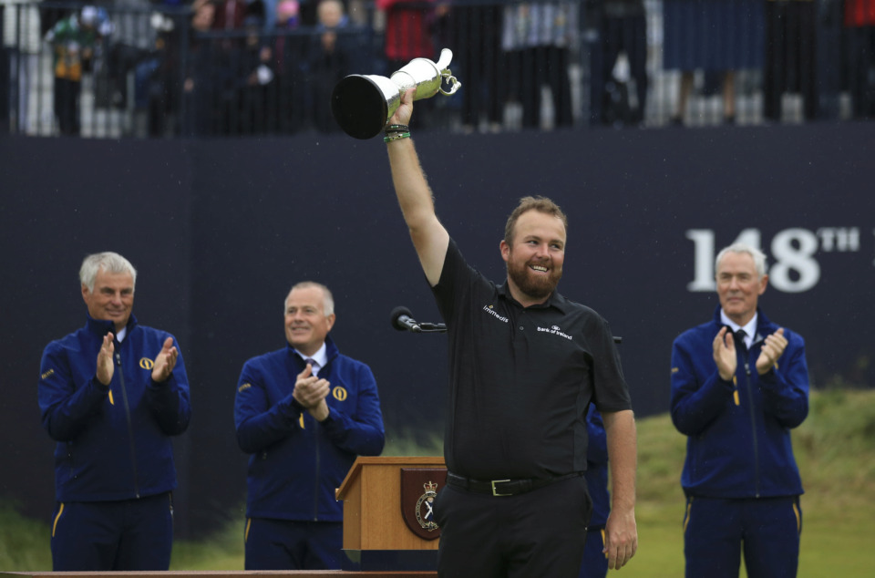 <span><strong>Ireland's Shane Lowry smiles as he holds the Claret Jug trophy aloft after being presented with it for winning the British Open Golf Championships at Royal Portrush in Northern Ireland, Sunday, July 21, 2019.</strong> (AP Photo/Jon Super)</span>