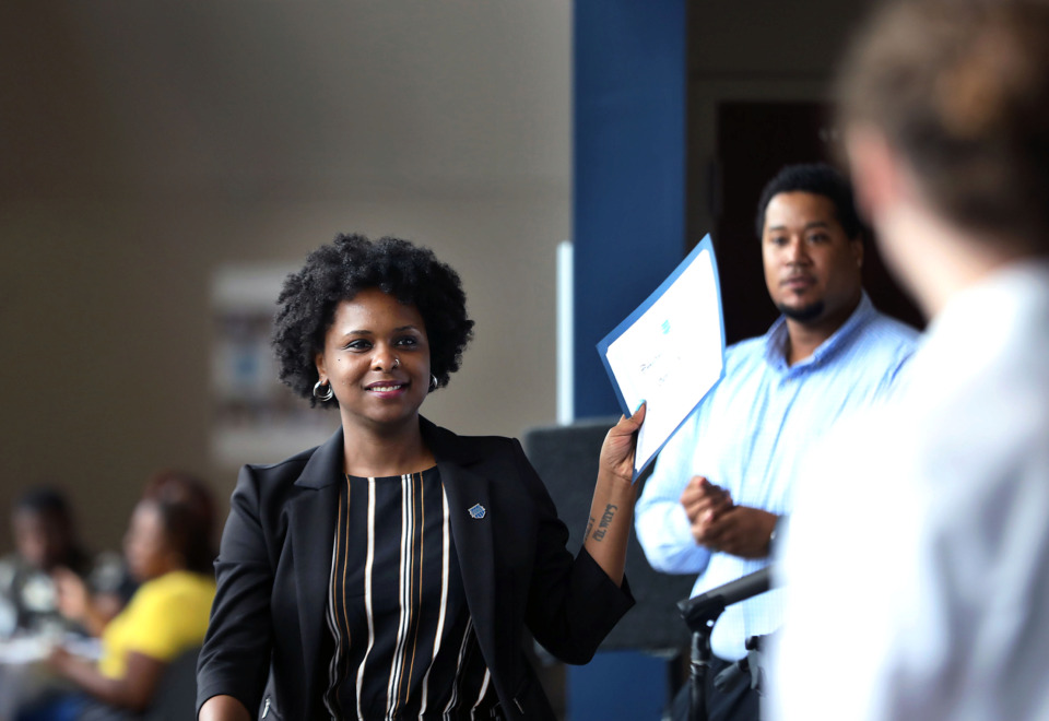 <strong>Danielle Nelson accepts her Peer Power Heart of Change award, which recognizes the success coach who demonstrated an extraordinary passion for their work, at the University of Memphis' Rose Theatre Monday, July 22.</strong> (Patrick Lantrip/Daily Memphian)