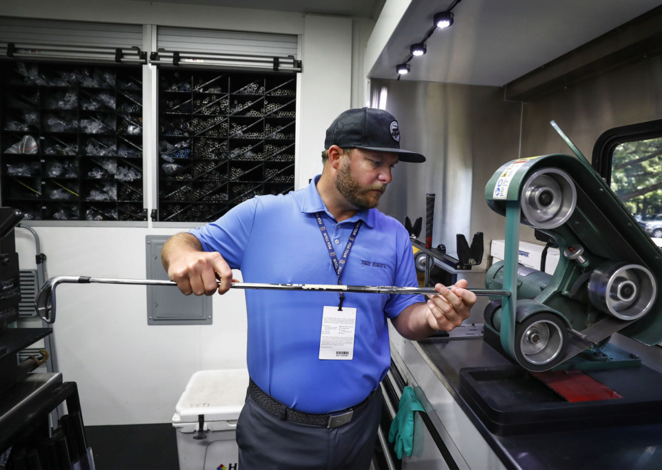 <strong>True Temper PGA club technician Justin Smith works on a new wedge on the company's touring truck during the WGC-FedEx St. Jude Invitational practice day at TPC Southwind Tuesday, July 23, 2019. True Temper, a local golf shaft company, plans to move its headquarters from Southwind to Downtown Memphis and rebrand itself as TRUE Sports.</strong> (Mark Weber/Daily Memphian)