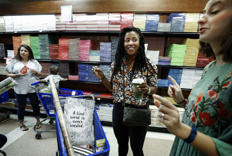 <strong>Forest Hill Elementary fourth-grade teacher Camellia Jones (center) gets help from sales associate Bekah Blake (right) during a shopping spree at the Knowledge Tree, Wednesday, July 24, 2019. Several Germantown area teachers were given a $120 to spend on supplies for the upcoming school year.</strong> (Mark Weber/Daily Memphian).