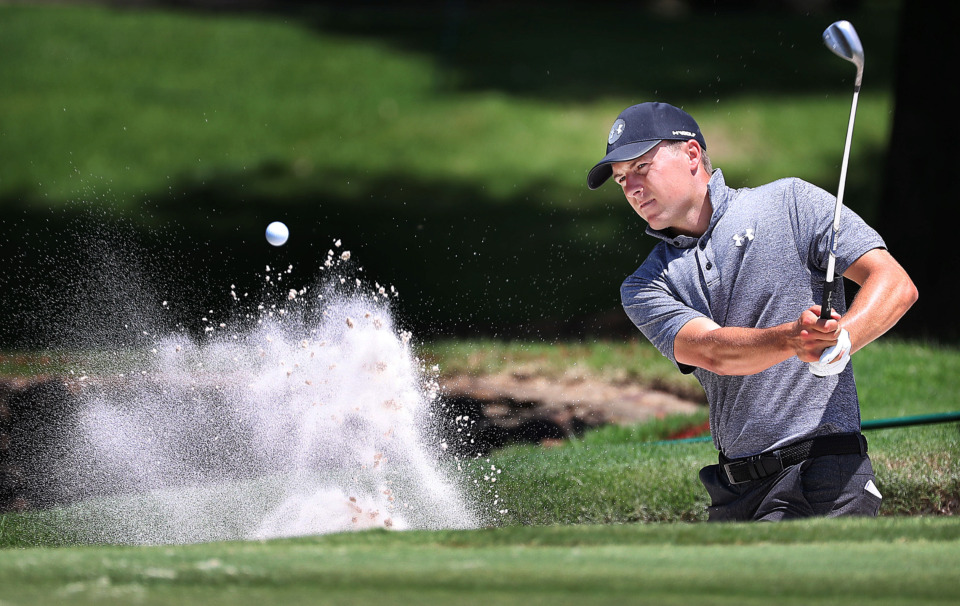 <strong>Jordan Spieth hits out of the sand on the 4th green during a day of practice rounds at the WGC - FedEx St. Jude Invitational at TPC Southwind on Wednesday, July 24, 2019.</strong> (Jim Weber/Daily Memphian)