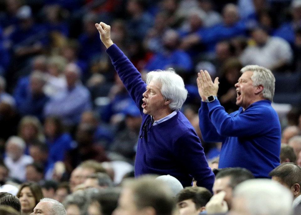 <strong>University of Memphis basketball fans cheer on the Tigers during a 2019 game against the Wichita State Shockers. Memphis averaged 7,840 more fans per game than during the 2017-18 season, when attendance average was just 6,225.</strong> (Houston Cofield/Daily Memphian)