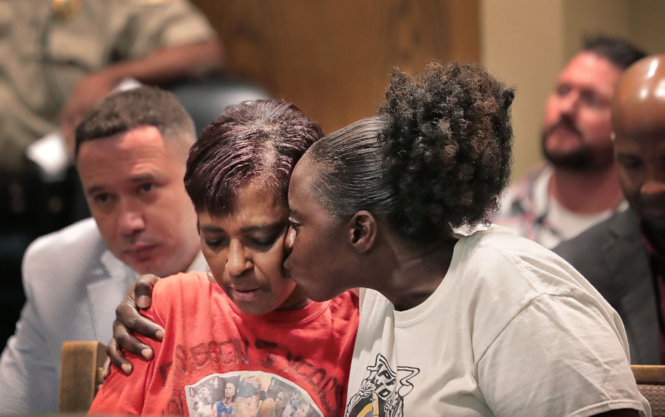 "<strong>Deborah Marion (left) mother of slain basketball player Lorenzen Wright, is comforted during a hearing in Judge Lee Coffee's court on July 25, 2019, where Sherra Wright&nbsp;</strong><span class=""s1""><strong>pleaded guilty to the&nbsp;charge of facilitation of first-degree murder in the 2010 death of her ex-husband.</strong> (Jim Weber/Daily Memphian)</span>"
