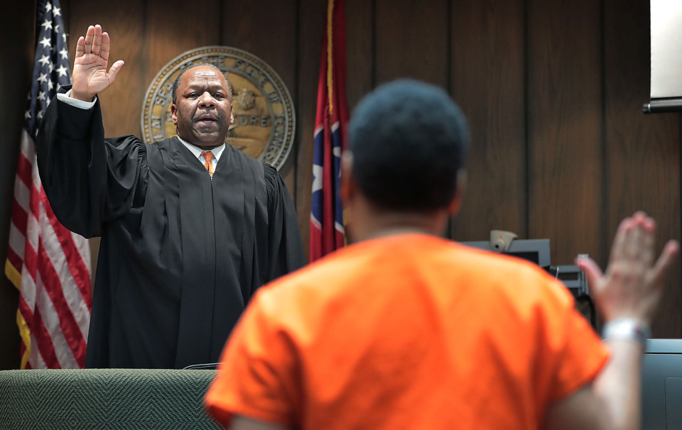 "<strong>Judge Lee Coffee swears in Sherra Wright during a July 25, 2019, hearing during which Wright pleaded guilty&nbsp;</strong><span class=""s1""><strong>to the&nbsp;charge of facilitation of first-degree murder in the 2010 death of her ex-husband, former Grizzlies player Lorenzen Wright. </strong>(Jim Weber/Daily Memphian)</span>"