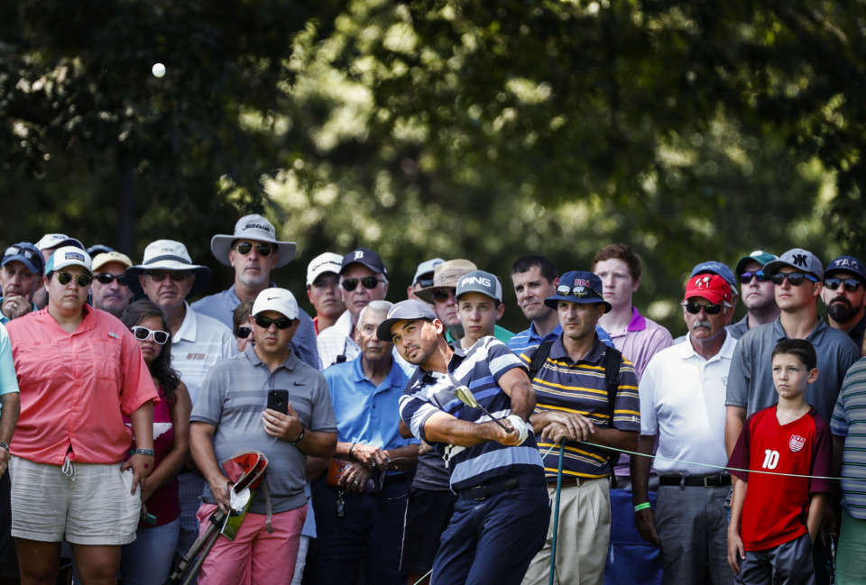 <strong>A large crowd watches as PGA golfer Jason Day hits from out of bounds on the second hole during first-round action at the WGC-FedEx St. Jude Invitational at TPC Southwind on Thursday, July 25, 2019.</strong> (Mark Weber/Daily Memphian).