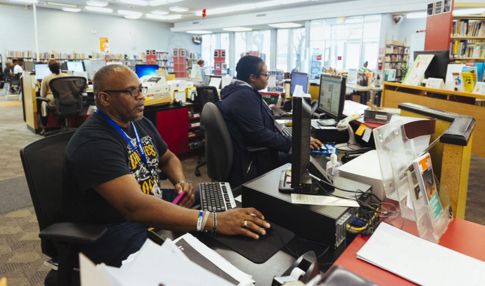 <strong>Jeffery McMiller and Kera Kelly work the front desk of the Frayser Library 3712 Argonne St., which is scheduled to be replaced with a new structure at 2220 James Road.</strong>&nbsp;(Ziggy Tucker/Special to The Daily Memphian)