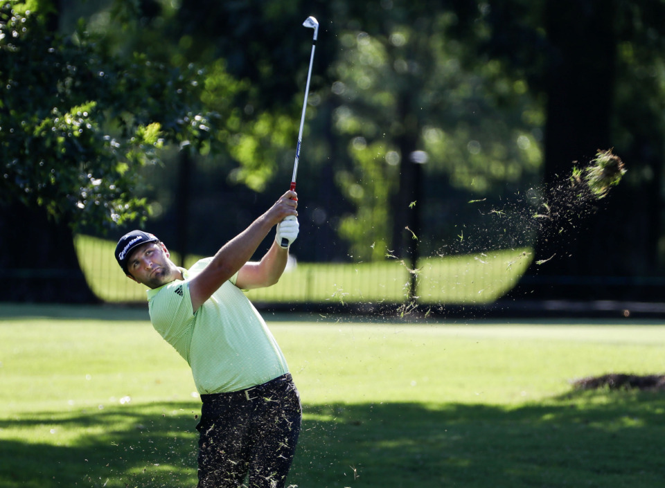 <strong>PGA golfer Jon Rahm hits a fairway shot on the ninth hole during first-round action at the WGC-FedEx St. Jude Invitational at TPC Southwind, Thursday, July 25, 2019.</strong> (Mark Weber/Daily Memphian)
