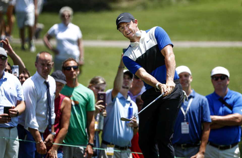 <strong>PGA golfer Rory McIlroy watches his shot head to the second green during the first round of the WGC-FedEx St. Jude Invitational at TPC Southwind, Thursday, July 25, 2019.</strong> (Mark Weber/Daily Memphian)