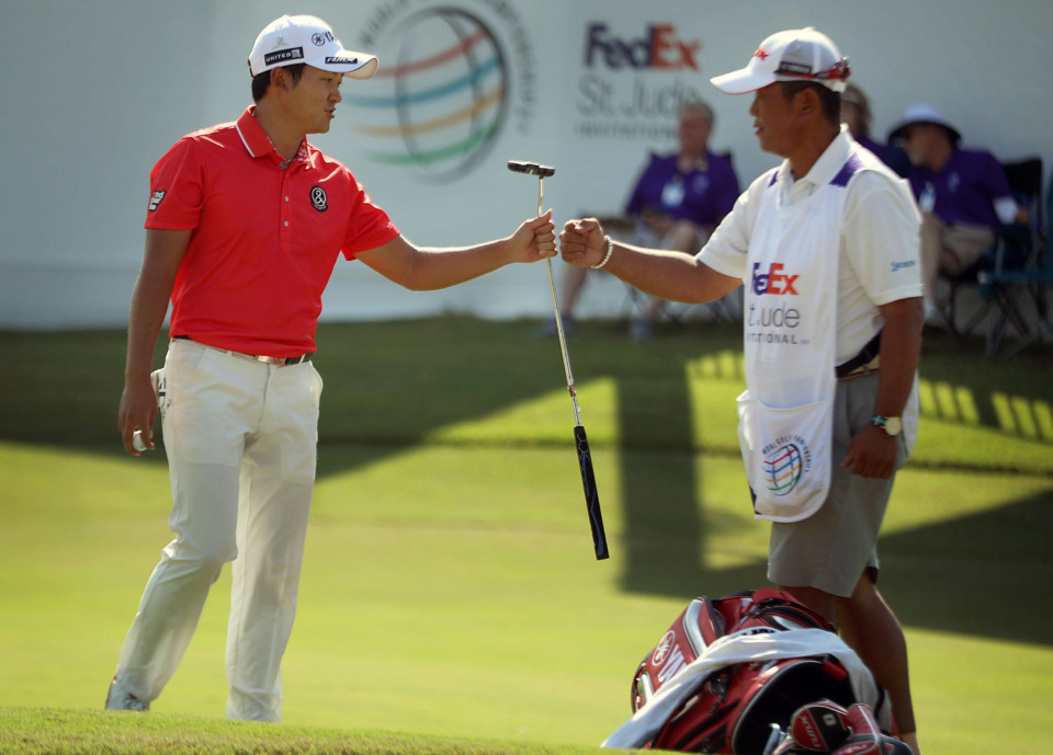 <strong>Shugo Imahira celebrates with his caddie after sinking an 18th-hole birdie during first-round action at the WGC-FedEx St. Jude Invitational at TPC Southwind, Thursday, July 25, 2019.</strong> (Patrick Lantrip/Daily Memphian)