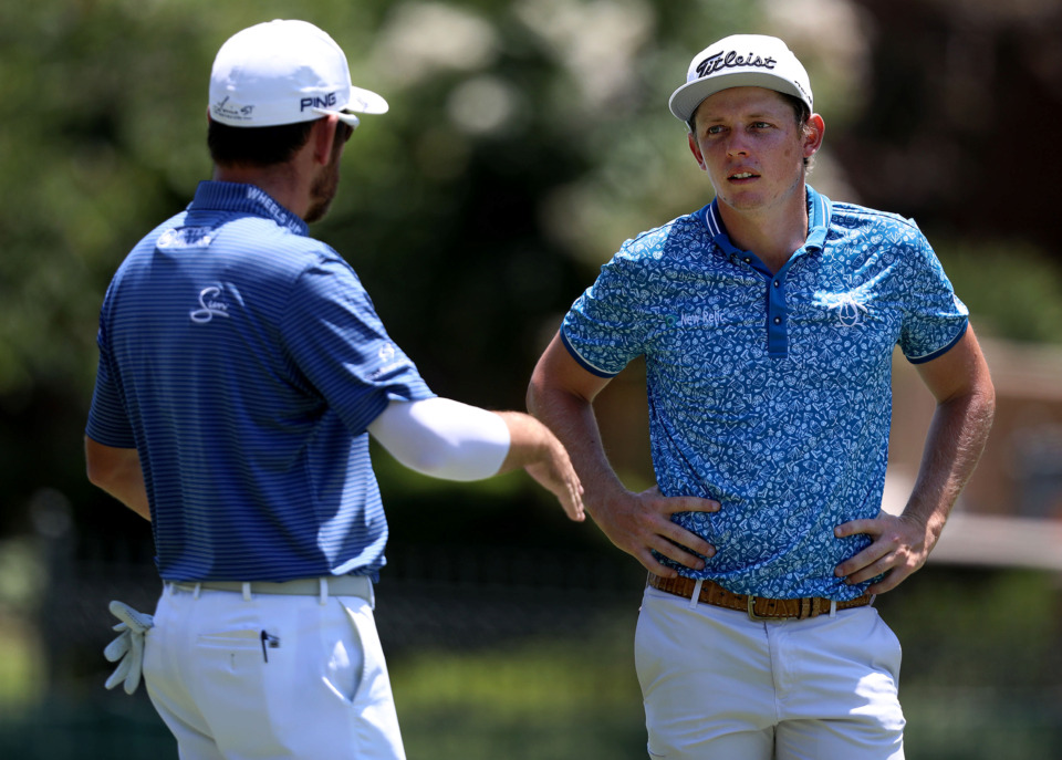 <strong>Cameron Smith of Australia talks to Brandt Snedeker while waiting on Louis Oosthuizen to hit a shot during first-round action at the WGC-FedEx St. Jude Invitational at TPC Southwind, Thursday, July 25, 2019.</strong> (Patrick Lantrip/Daily Memphian)