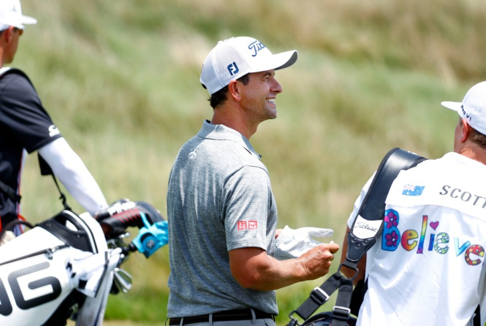 <strong>Adam Scott smiles to his caddie after hitting a drive down the 10th fairway during the WGC-FedEx St. Jude Invitational on July 26, 2019, at TPC Southwind.</strong> (Houston Cofield/Special to The Daily Memphian)