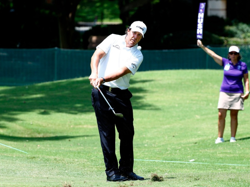 <strong>Phil Mickelson chips onto the 10th green during the WGC-FedEx St. Jude Invitational on July 26, 2019, at TPC Southwind. Mickelson played through the back nine just one shot under par Friday.</strong> (Houston Cofield Special To The Daily Memphian)