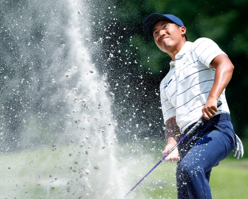 <strong>C.T. Pan blasts the ball out of a deep bunker near the 16th green during the second day of the WGC-FedEx St. Jude Invitational on July 26, 2019, at TPC Southwind.</strong> (Houston Cofield Special To The Daily Memphian)