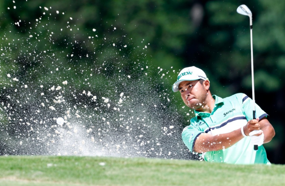<strong>Hideki Matsuyama hits out of the bunker on the 16th hole during the WGC-FedEx St. Jude Invitational on July 26, 2019, at TPC Southwind.</strong> (Houston Cofield Special To The Daily Memphian)