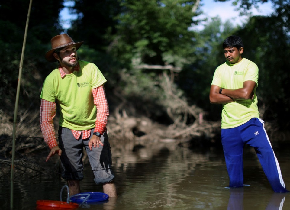 <strong>Rodrigo Villalpando-Vizcaino and Sagar Pandit with the University of Memphis Center for Applied Earth Science and Engineering Research explain to a group of volunteers on Friday, July 27, 2019, how charges used to detect breaches in the Memphis aquifer will be implemented on the banks of the Wolf River.</strong> (Patrick Lantrip/Daily Memphian)