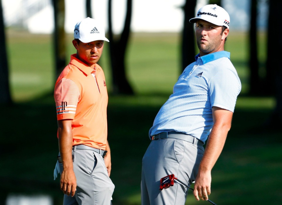 <strong>Jon Rahm (right) reacts to a missed putt as Xander Schauffele (left) makes his way around the perimeter of the green during second-round play at the WGC-FedEx St. Jude Invitational on July 26, 2019.</strong>&nbsp;(Houston Cofield/Special to The Daily Memphian)
